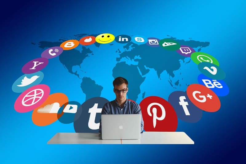 Blogging for fun not profit - social media icons in a circle with world map background